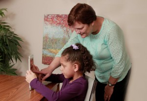 2015, Little girl and teacher with iPad (2)